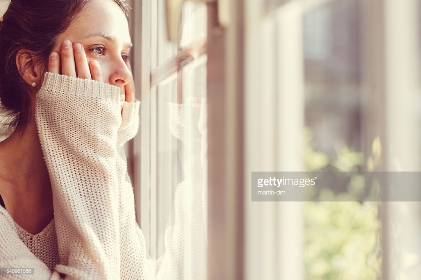 Girl looking through the window
